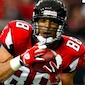 Tony Gonzalez Catches Everything but the Hobby's Attention