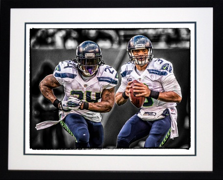 Russell Wilson, Marshawn Lynch Seattle Seahawks Framed Print